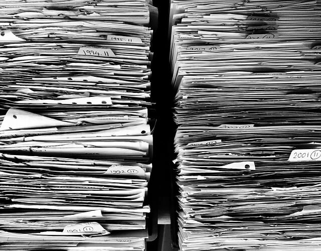 stacks of tax files and paperwork